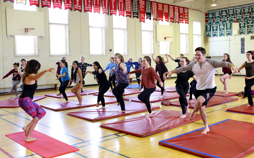 "Teaching a variation of Eagle Pose which Lisa calls ""Great Blue Heron"". Yoga by Design offered three yoga classes to high school students at the 2016 Annual Social Justice & Equity Conference, Malvern Collegiate, Toronto."