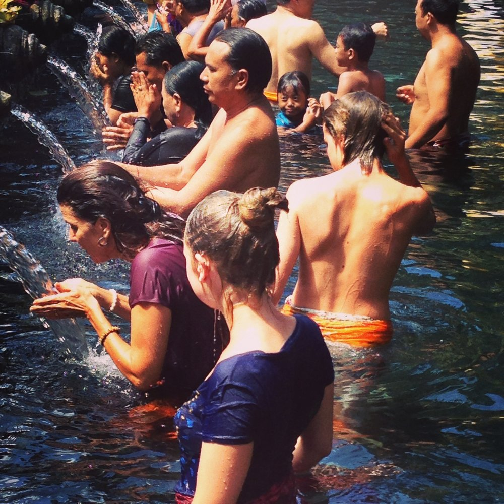Tirta Empul, Bali, is one of the largest and most sacred water temples in Indonesia. The temple was founded in 926 A.D. and is dedicated to Vishnu, the Hindu God of Water. We'll be joining locals in our sarongs, bringing floral offerings and performing cleansing rituals with water fed from a natural spring.