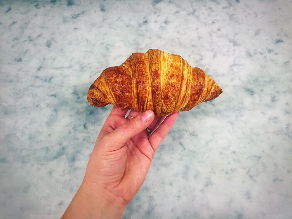Holding Croissant.JPG