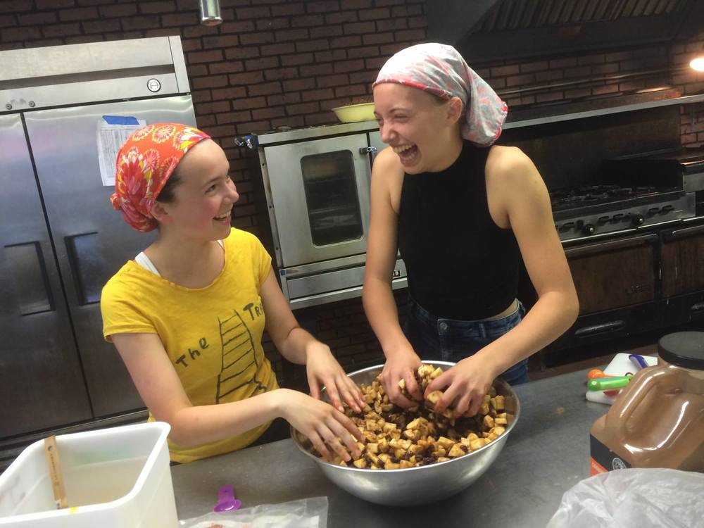 One way we explore diversity at Camp is through meals. During the season, campers cook and serve meals from their home country for the staff and other campers.