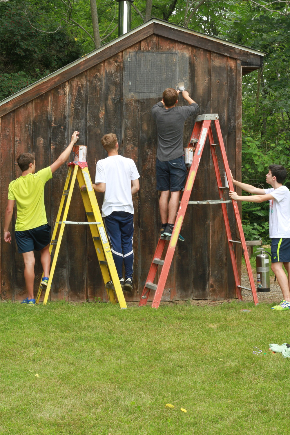 Campers fixing up the on-site Finnish sauna.