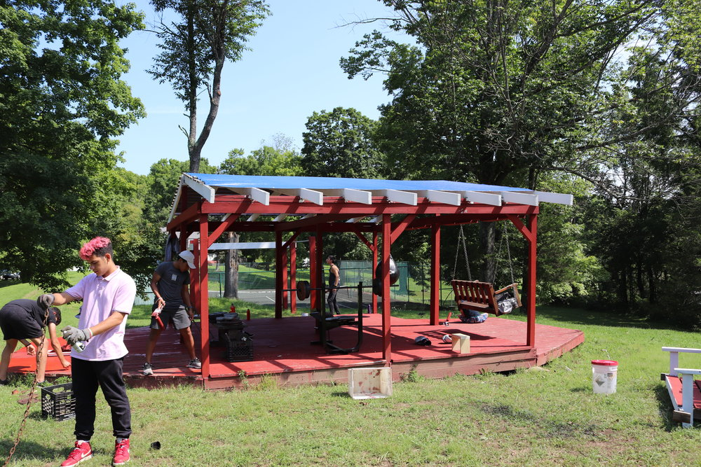 Gazebo Project - The group working on the Gazebo is making a variety of improvements and additions to the Gazebo, which itself was a project for it's initial construction a couple years ago. In conjunction with adding a fresh coat of paint they've added a pull-up bar, a dip bench, and brought over a swing and bench press from the Red Hook campus and incorporated them into the Gazebo, creating an excellent outdoor workout space.