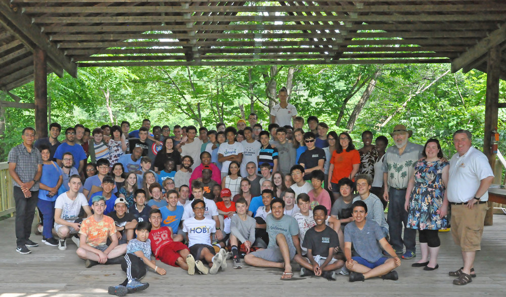 Group photo from 2017 of David Ives and Leymah Gbowee's visit to Camp Rising Sun
