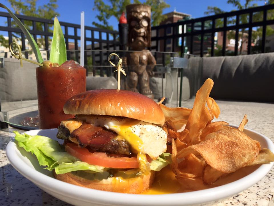If you're looking for more Sunday Fun-day options downtown, then look no further! Indulge in The Sidecar's gooey Brunch Burger topped with bacon, Sriracha cheddar, Bloody Mary Ketchup, and a fried egg.