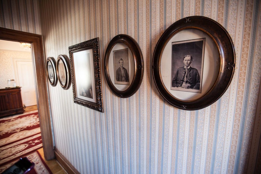Walls lined with historic photographs (Sion Bass House)