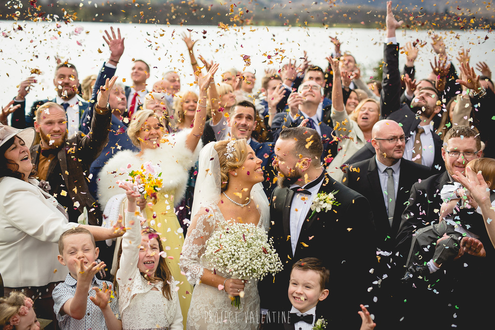 wedding guests throwing confetti