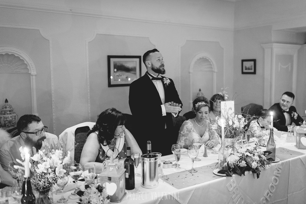groom giving speech during wedding breakfast