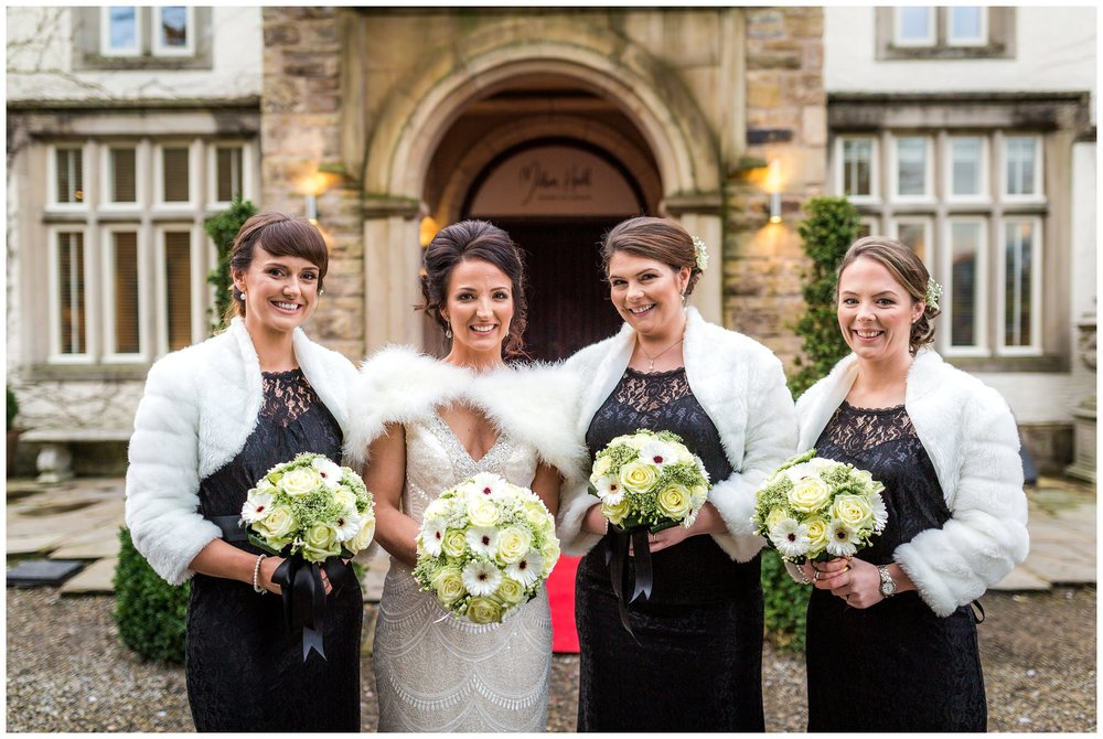 bride smiling with bridesmaids portrait