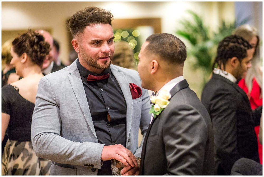 guest congratulating the groom