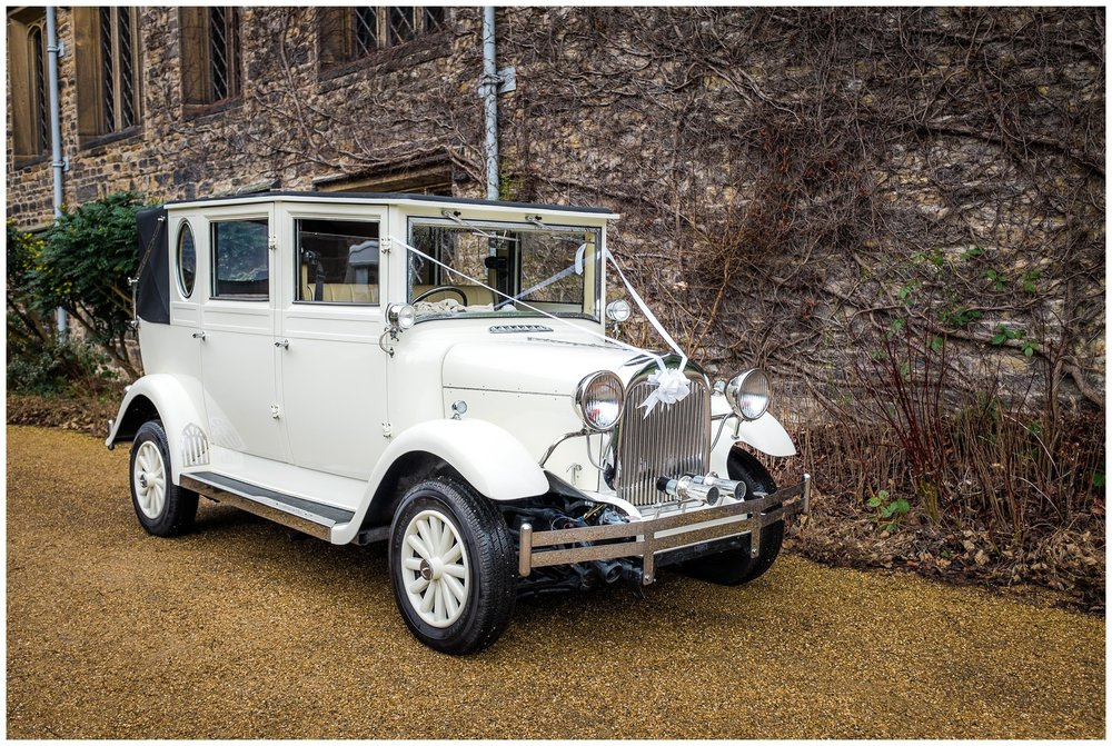 a white wedding car outside of towneley hall