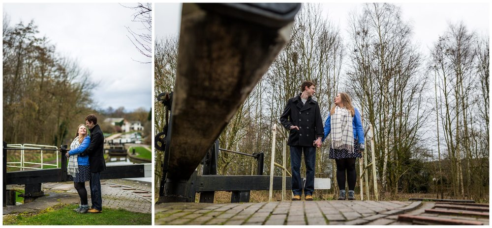 couple stood by canal lock