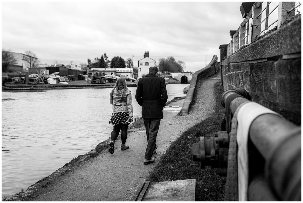 black and white picture of couple walking up the canal