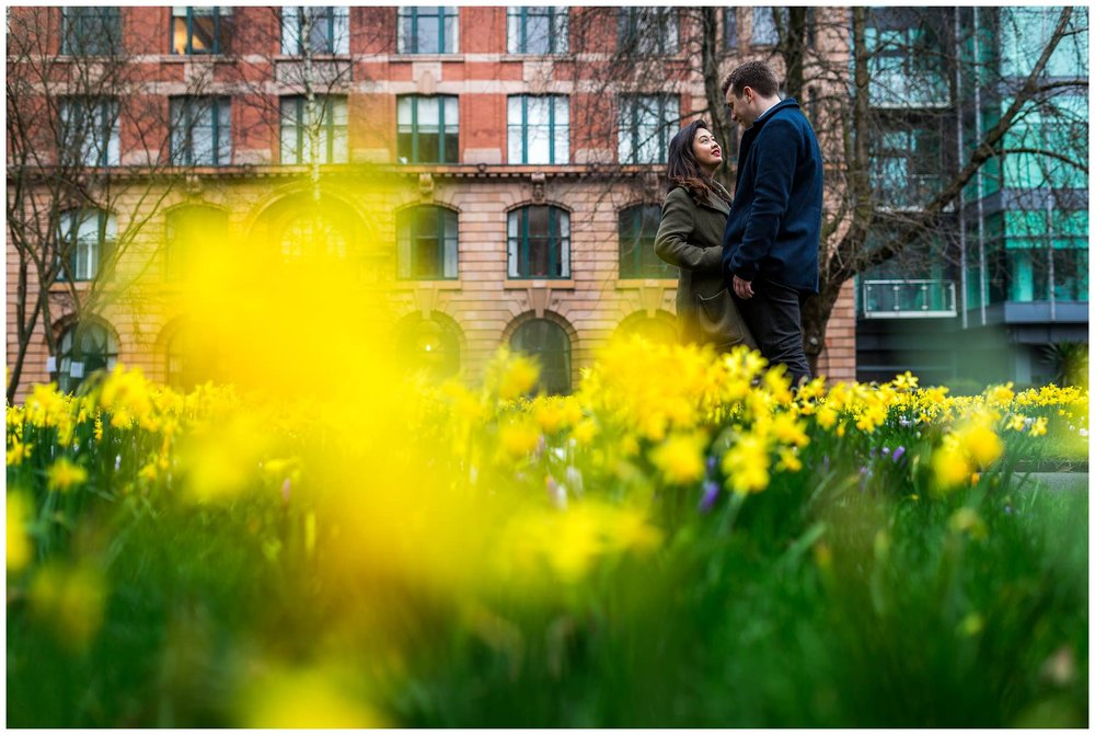 shot of couple with daffodils