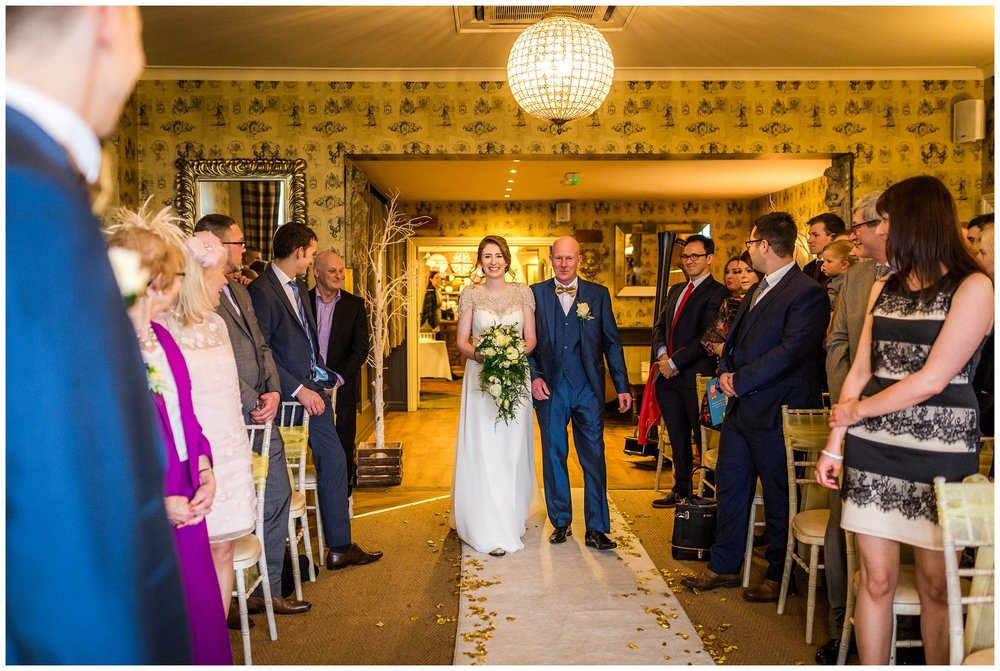 bride walking up the aisle at the shireburn arms, north west