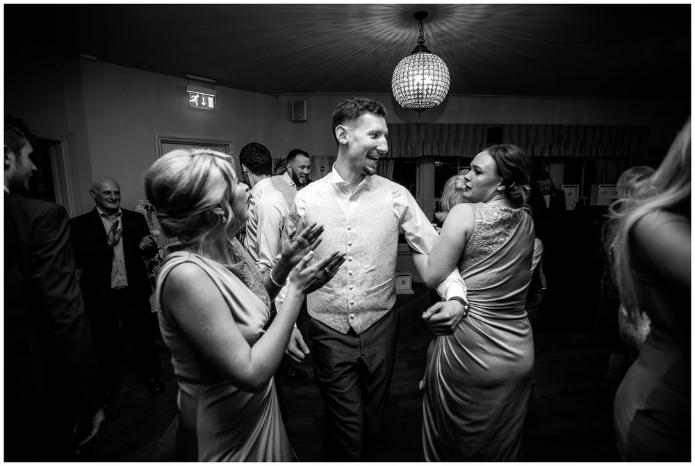 groom dancing with guests