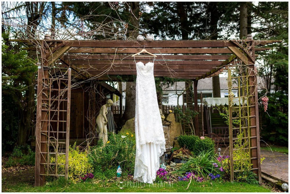 the wedding dress hung outside
