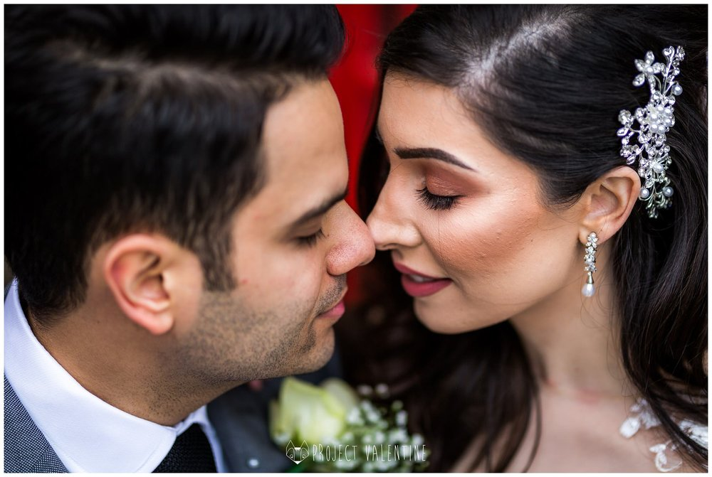 close up of bride and groom nose to nose