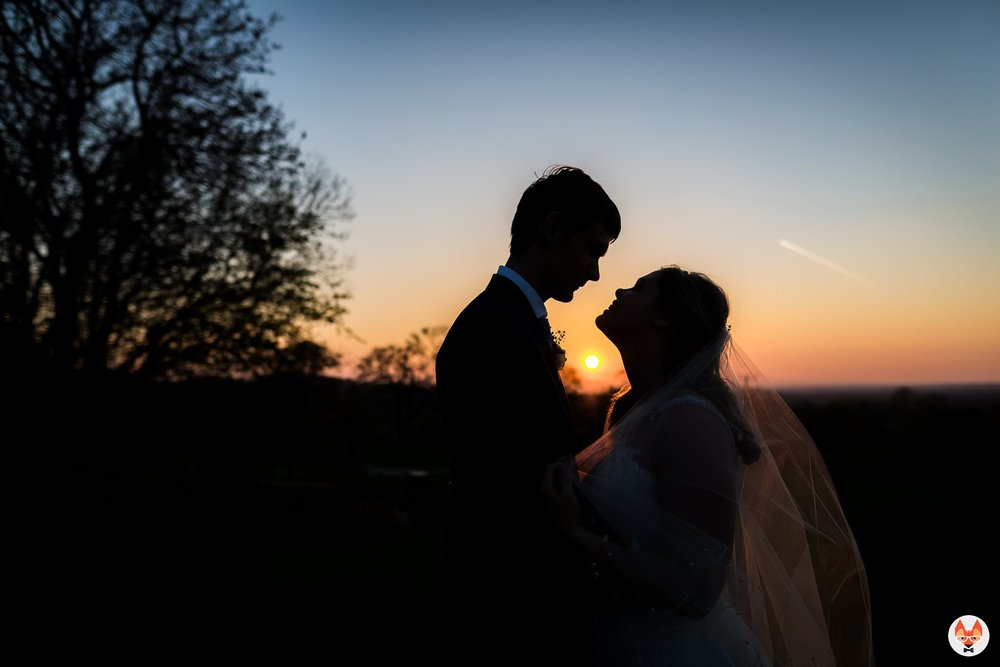 bride and groom portrait as sun sets