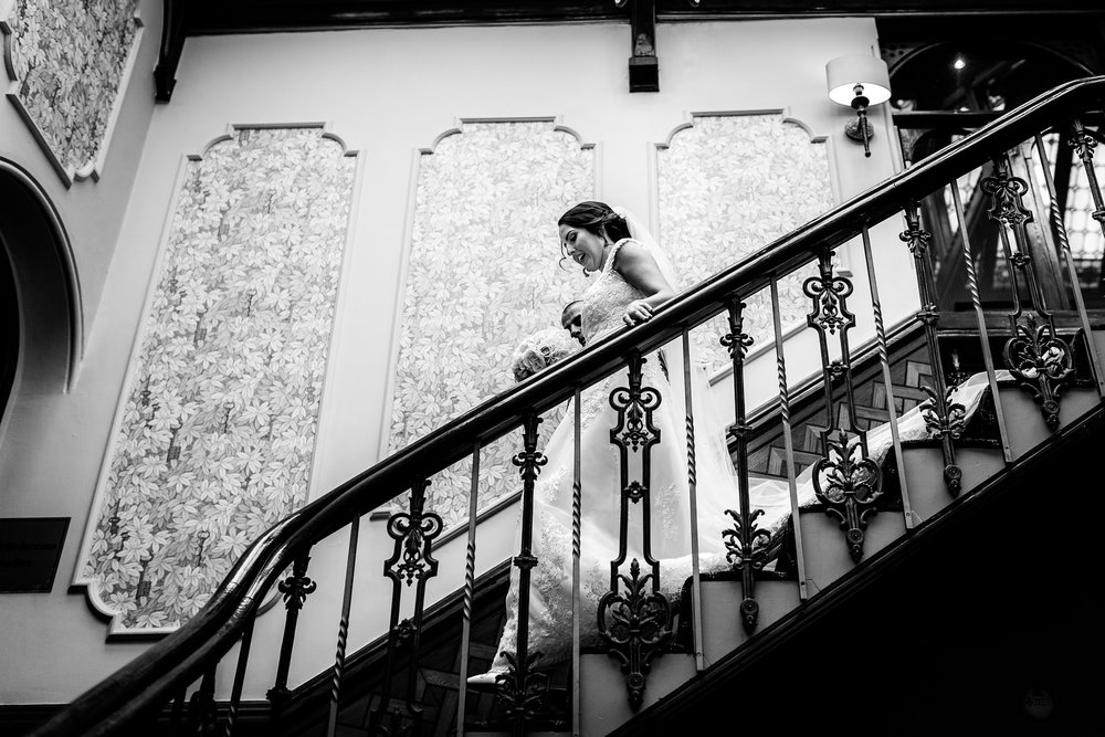 bride walking down stairs at kilhey court, lancashire