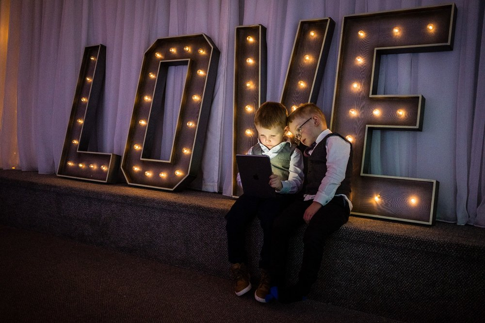 children sat in front of love letters