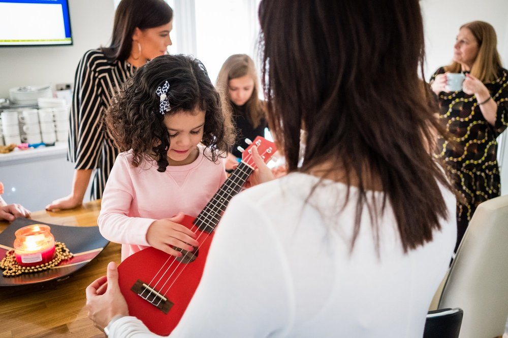 little girl playing guitar