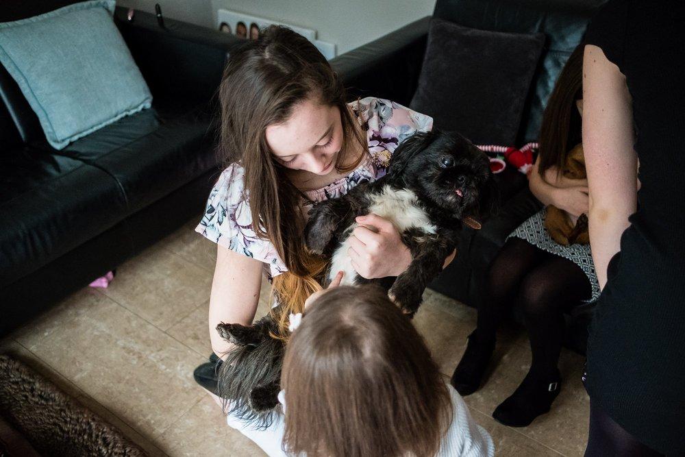 girl hold family dog