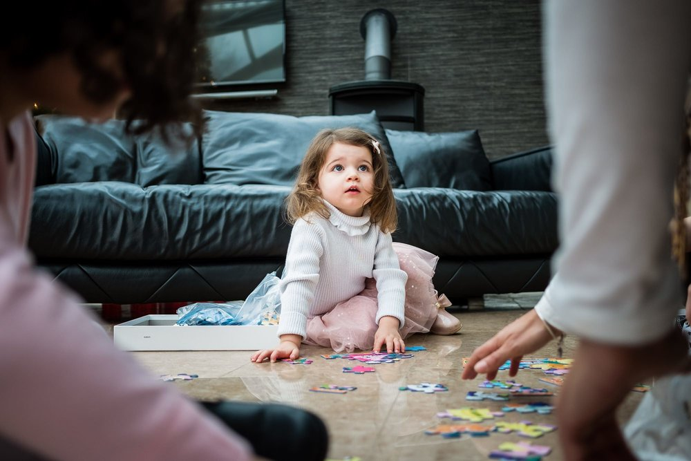 little girl on floor with toys