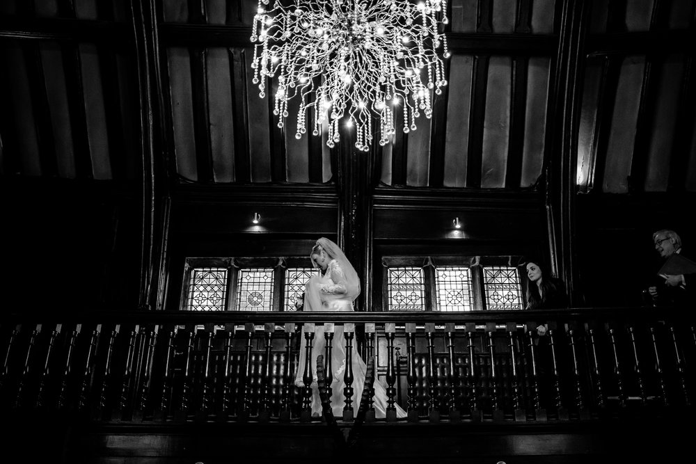 bride walking through mitton hall, lancashire