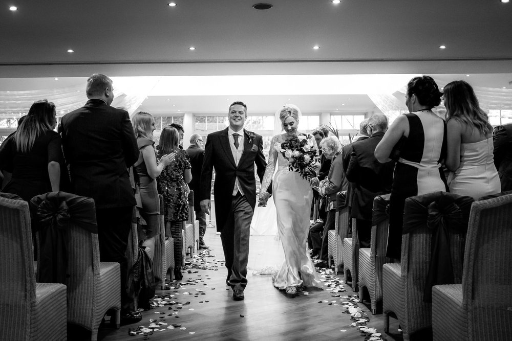 bride and groom walking down the aisle together