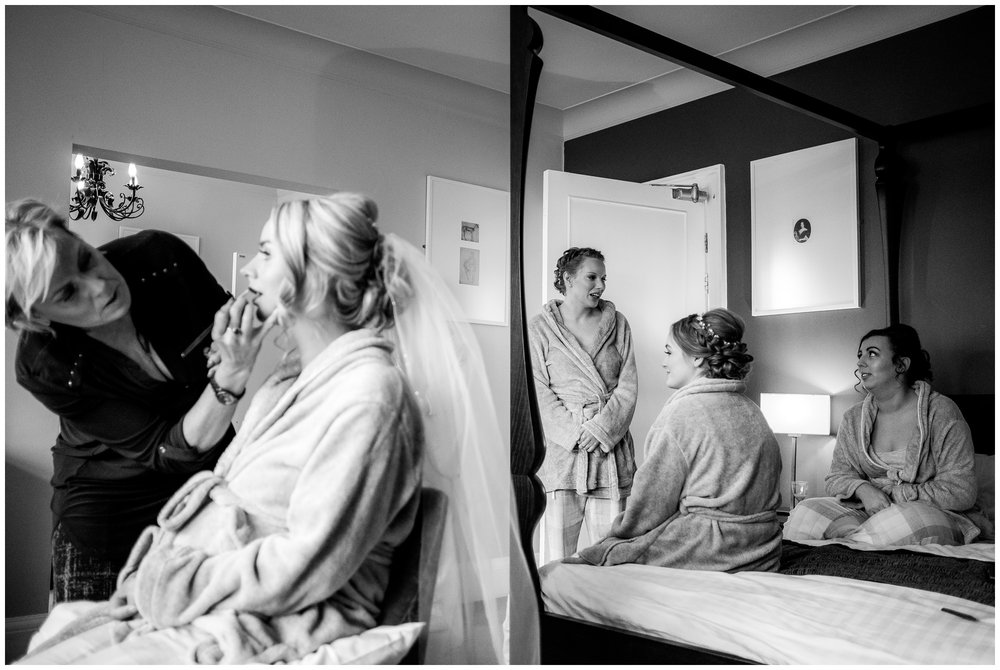 bridesmaids watching as bride has her makeup done