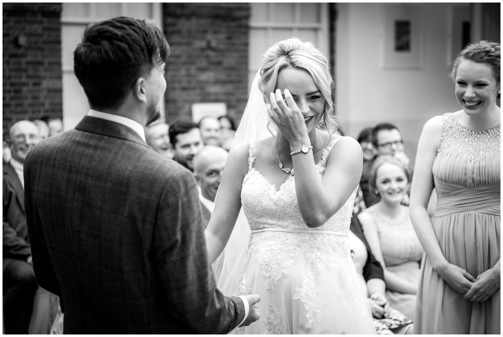 bride laughing during the service at the White Hart Hotel, Lincoln