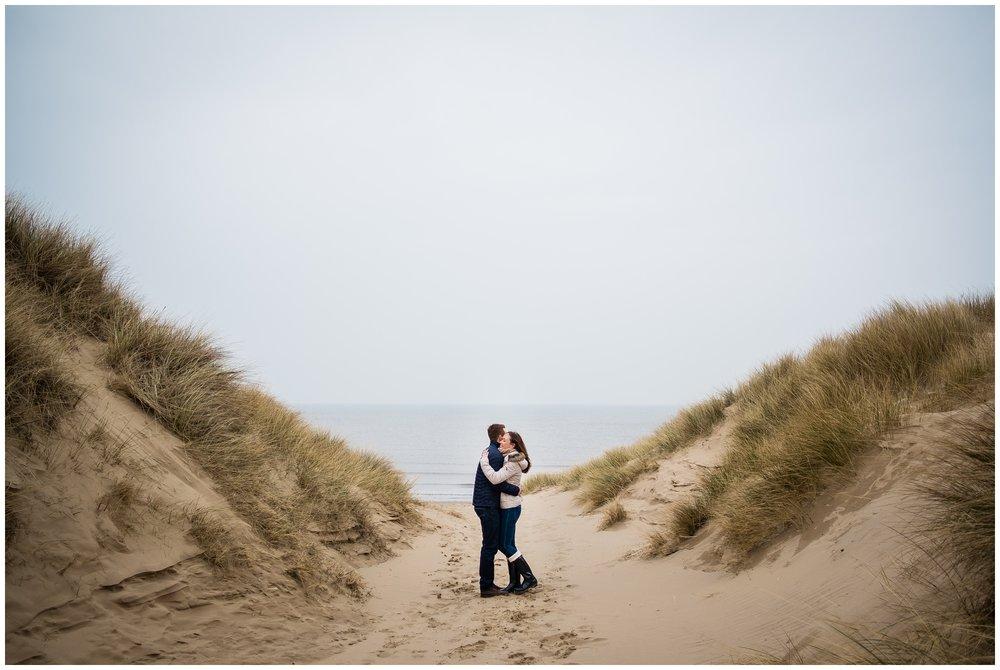 couple between sand dunes