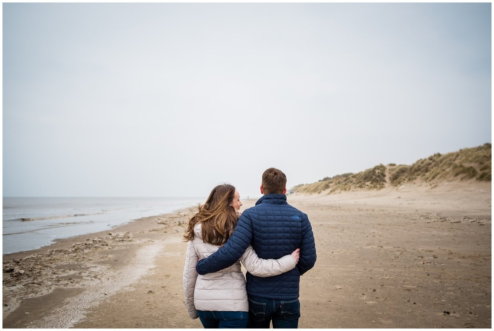 couple walking up the beach