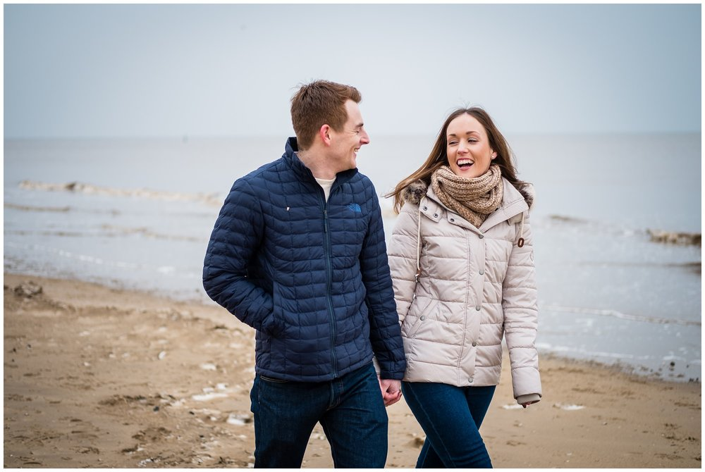 bride to be laughing on beach