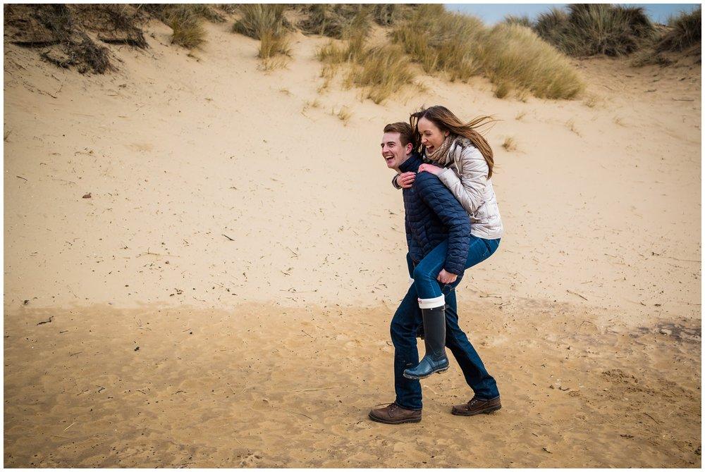 fiancé running on sand