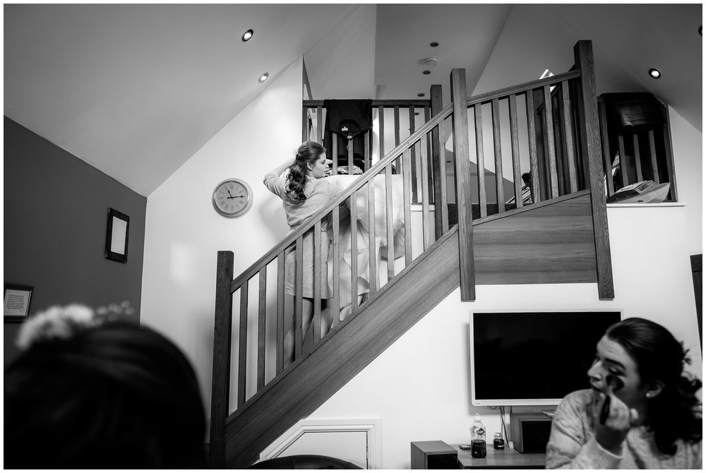 wedding dress being brought upstairs