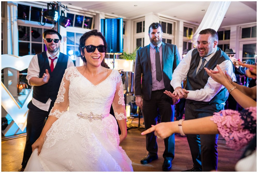 bride with sunglasses on