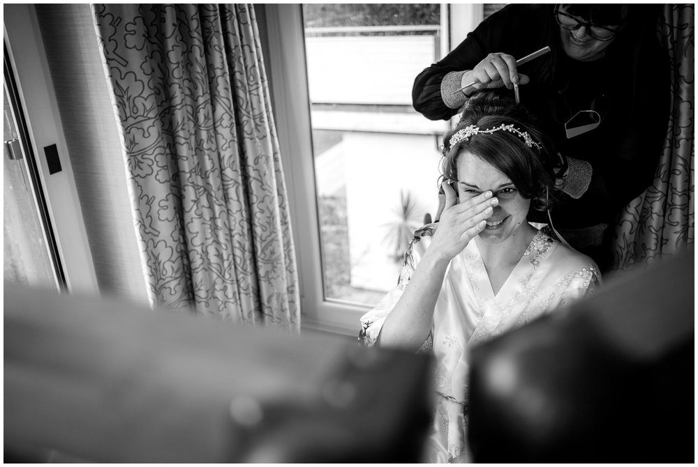bride crying while getting ready