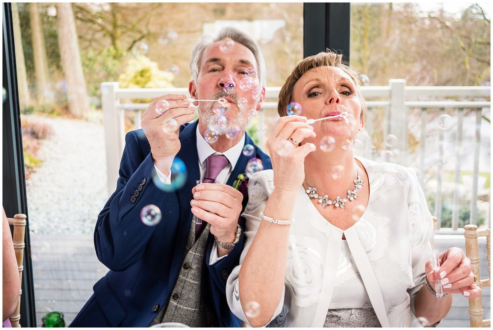 guests blowing bubbles