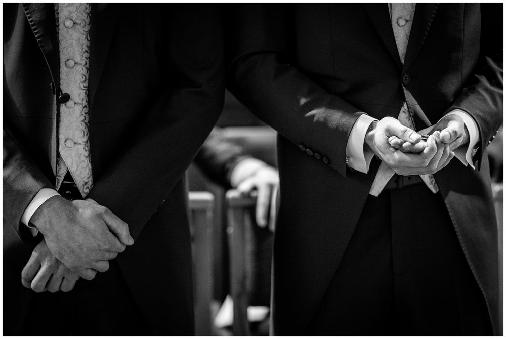 best man holding wedding rings