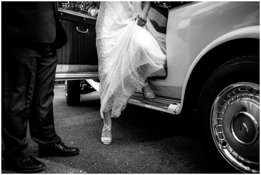 bride stepping out of wedding car at ashfield house, lancashire