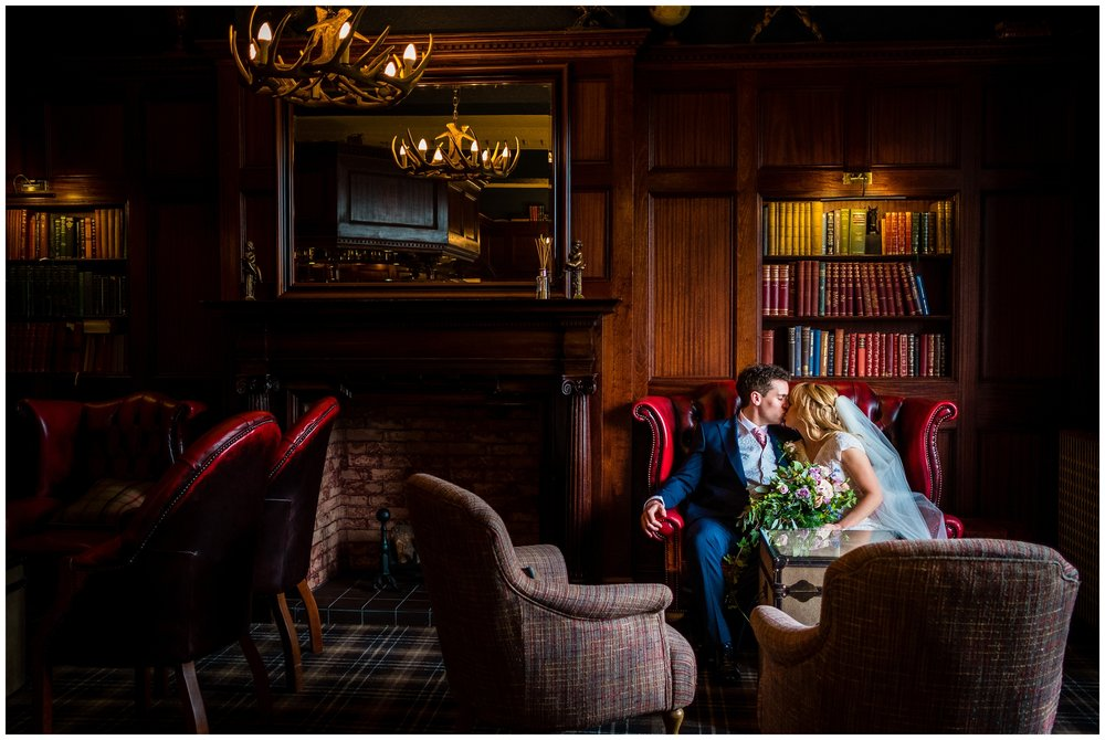 bride and groom in library room at ashfield house