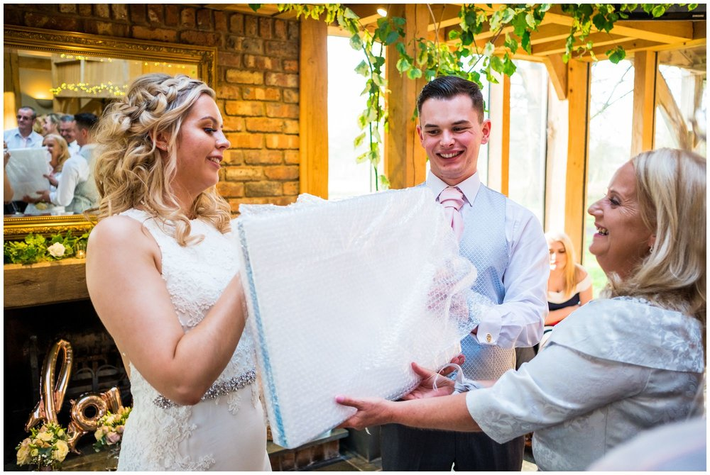 bride and groom receiving gifts