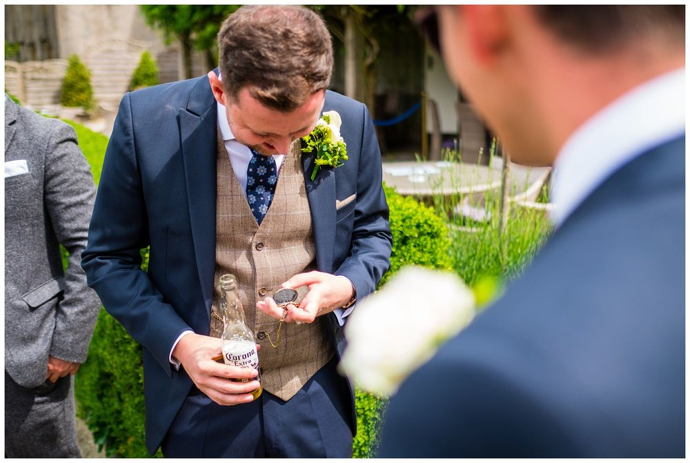 groom checking out his new pocket watch