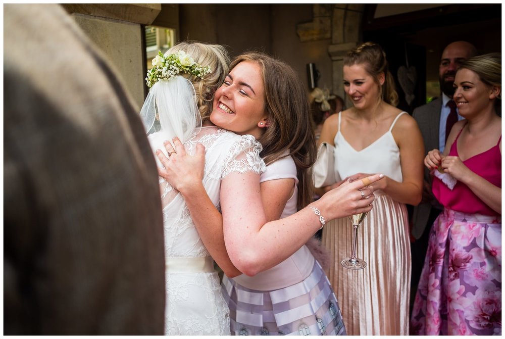 bride receiving a hug