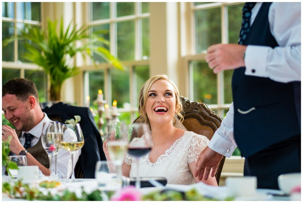 bride watching dad give his speech