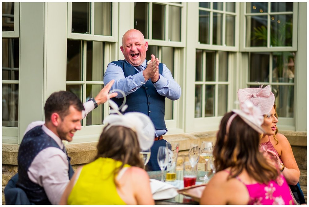 guests laughing outside after meal