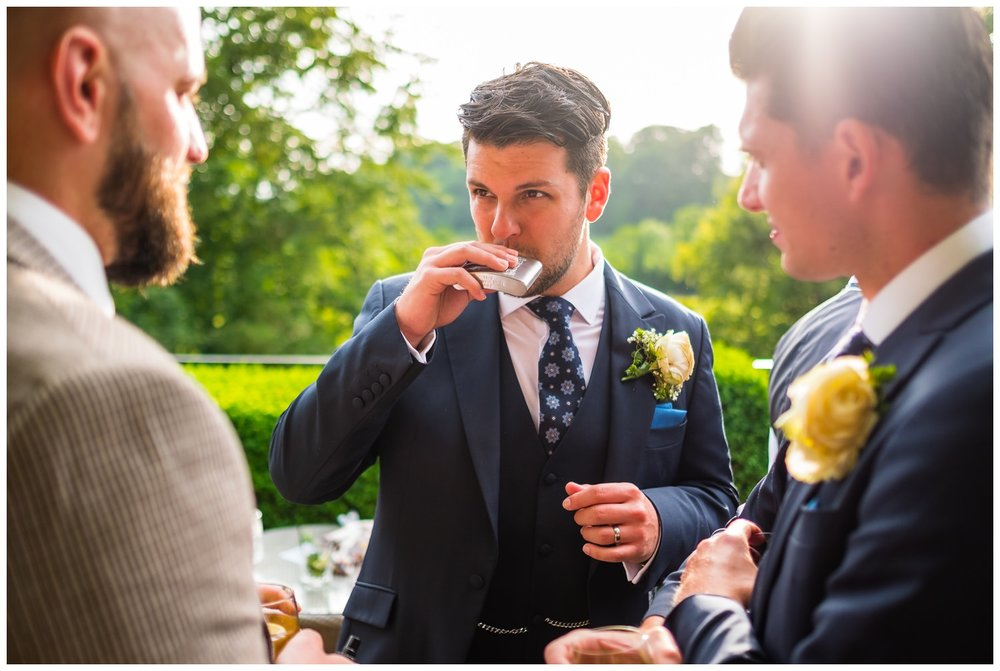 groomsmen with hip-flask