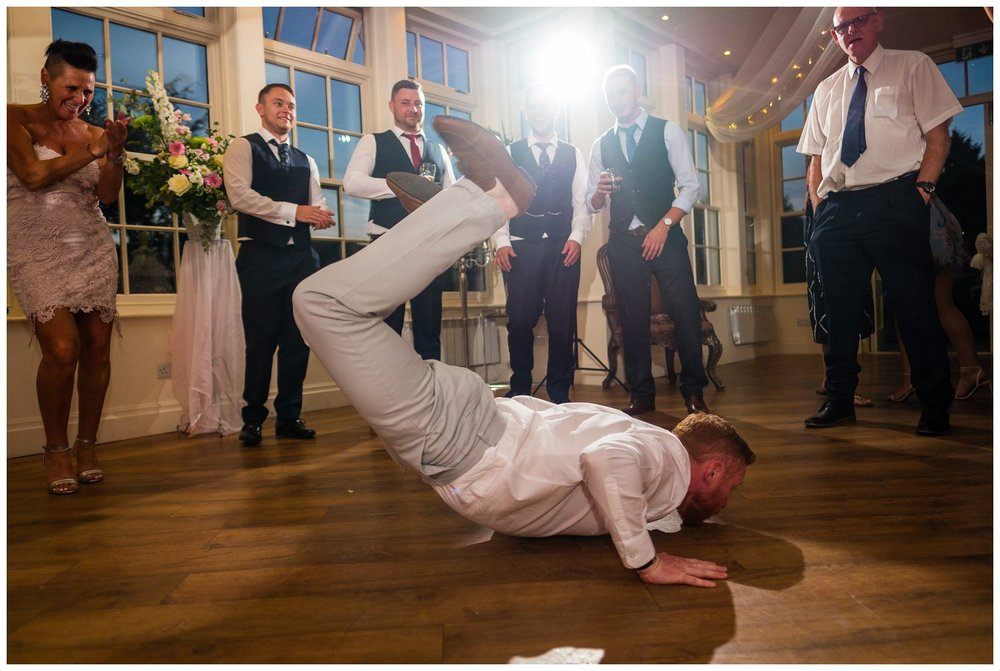 guest doing the worm at wedding