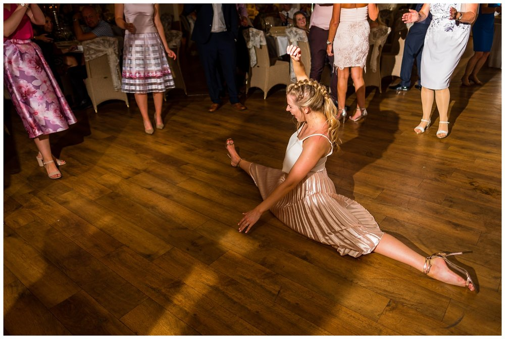 wedding guest doing the splits
